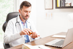 Doctor taking some pills for himself Royalty Free Stock Images