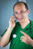 Doctor talking on cell phone Stock Photography