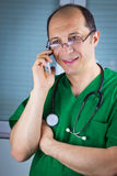 Doctor talking on cell phone Royalty Free Stock Image