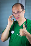 Doctor talking on cell phone Stock Photo