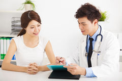 doctor talking with female patient in  office Royalty Free Stock Photography