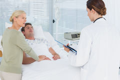 Doctor talking with her patients mother Royalty Free Stock Image