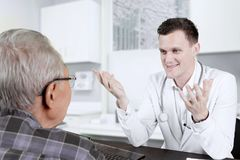 Doctor talking with his patient in the clinic Royalty Free Stock Photography