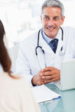Doctor talking with his patient Stock Images