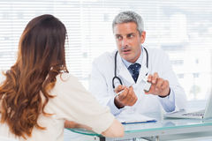Doctor talking with his patient seriously Royalty Free Stock Photo