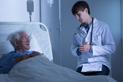 Doctor talking with ill man Royalty Free Stock Image