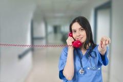Doctor talking. On the landline Royalty Free Stock Photos
