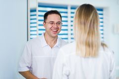 Doctor talking and laughing with his nurse assistant royalty free stock images