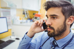 Doctor talking on mobile phone Stock Photography