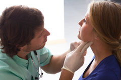 GP examining woman Stock Image