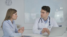 Doctor Talking with Patient, Discussing Health Treatment Plan stock footage