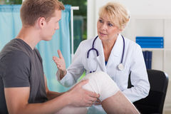 Doctor talking with patient Stock Photos