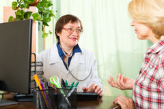 Doctor  talking with the patient Stock Photography