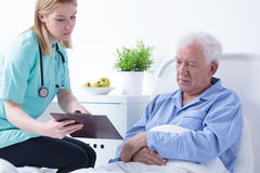 Doctor talking with patient Royalty Free Stock Photo
