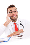 Doctor talking on the phone in the office Royalty Free Stock Image