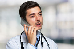 Doctor talking on the phone. Portrait of a doctor talking on the phone Royalty Free Stock Images