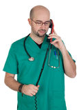 Doctor talking on a red phone Royalty Free Stock Images