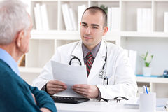 Doctor talking with senior  patient Royalty Free Stock Images