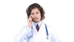 Doctor talking on smartphone royalty free stock image