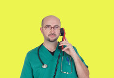 Doctor talking on telephone Royalty Free Stock Photos