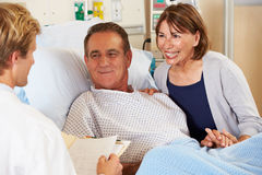 Doctor Talking To Couple On Ward Stock Photography