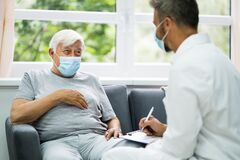 Free Doctor Talking To Elderly Patient Stock Photography - 189288222