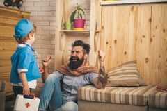 Doctor talking to happy patient, recovery from disease, successful treatment, health concept. Father and son playing stock photos