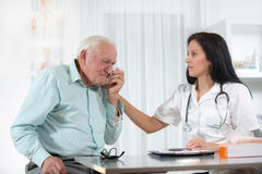 Doctor talking to her male senior patient at office. Female doctor and senior man Stock Images
