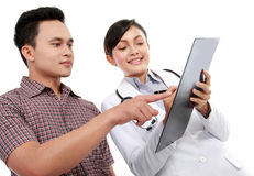 Doctor talking to a male patient Stock Photos