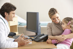 Doctor talking to mother and child Royalty Free Stock Photo