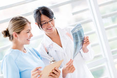 Doctor talking to a nurse Stock Image