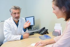 Doctor talking to patient Stock Image