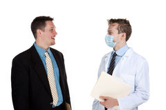 Doctor talking to a patient Royalty Free Stock Images
