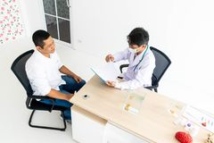 The doctor is talking to the patient. stock photo