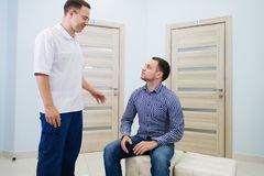 Doctor talking to a patient in a hallway.  royalty free stock photography