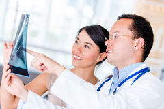 Doctor talking to a patient Stock Photos