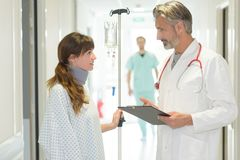 Doctor talking to patient in hospital corridor royalty free stock photo