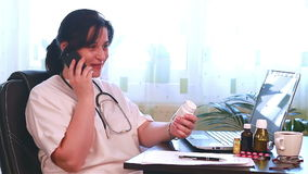 Doctor talking to patient on the phone about medicine stock video footage