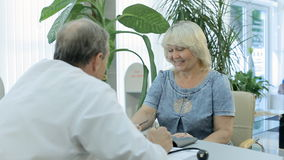 Doctor talking to patient at a reception stock footage