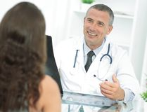Doctor talking to patient sitting at the table. The concept of health Royalty Free Stock Images