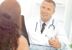 Doctor talking to patient sitting at the table. The concept of health Royalty Free Stock Photography
