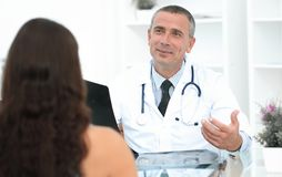 Doctor talking to patient sitting at the table. The concept of health Royalty Free Stock Image
