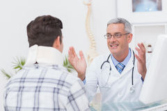 Doctor talking to patient wearing neck brace Stock Photo