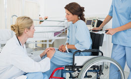 Doctor talking to a patient in wheelchair at hospital Royalty Free Stock Image