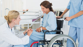 Doctor talking to patient in wheelchair at hospital Royalty Free Stock Photography