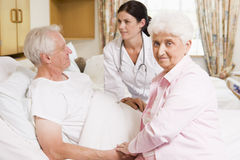Doctor Talking To Senior Couple Stock Photos
