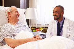 Doctor Talking To Senior Male Patient In Hospital Bed Royalty Free Stock Images