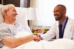Doctor Talking To Senior Male Patient In Hospital Bed Royalty Free Stock Photography