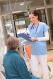 Doctor talking to senior patient in hospital Stock Image
