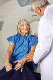 Doctor talking to senior patient at MRI Royalty Free Stock Image